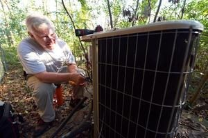 Terry Everett of Bob Woodall Air Care Systems checks an air conditioner on Dec. 10. Jay Hare / Dothan Eagle
